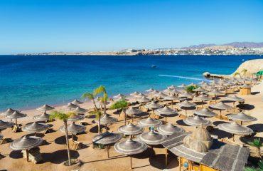 The beach in Egypt The big deserted beach. Closed beach and sun loungers. Egypt